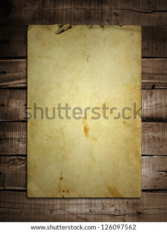 old paper on brown wood - stock photo
