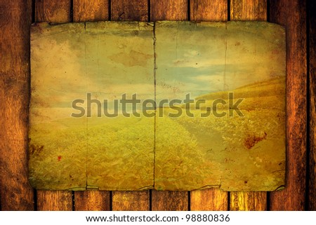 old paper on brown wood back ground - stock photo