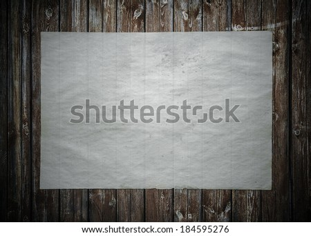 old paper on grunge wood texture, vintage background