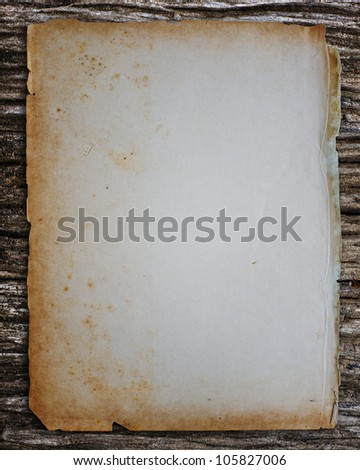 Old paper on old wood. - stock photo