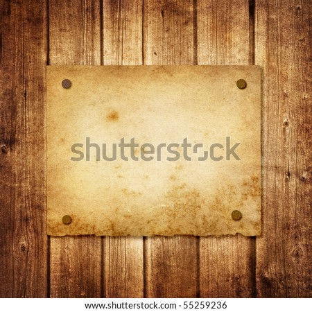 Old paper on the wood background - stock photo
