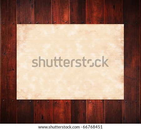 Old paper on the wood background. - stock photo