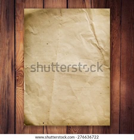 old paper on wood background and texture - stock photo