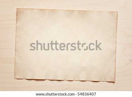 old paper on wooden board - stock photo