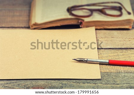 old paper, pen fountain, old book and glasses - stock photo