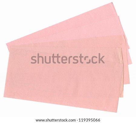 old paper pink slips isolated on a white background. This paper is from the 1960s and is a high resolution scan.  - stock photo