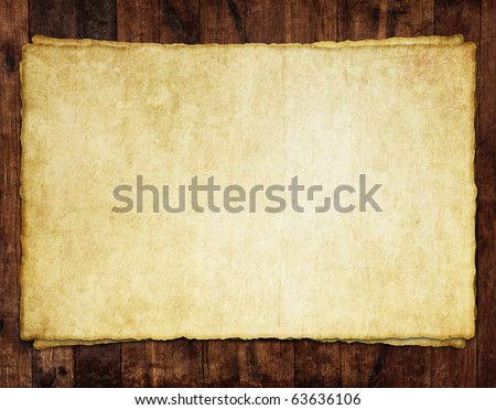 Old paper sheet on wooden background - stock photo