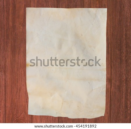 Old paper sheet, Vintage aged old paper, dirty paper on wood background or texture. - stock photo