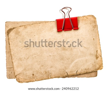 old paper sheets with clip isolated on white background. grunge cardboard texture - stock photo