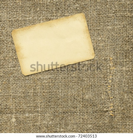Old paper tag on the sacking - stock photo