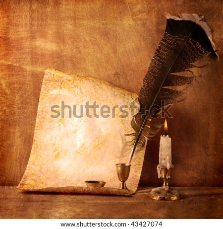 Old paper with a candle and a quill pen - stock photo