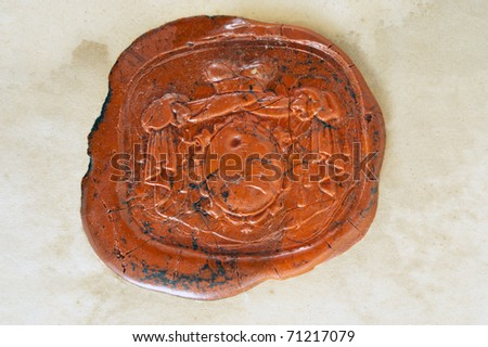 Old paper with a red wax seal. - stock photo