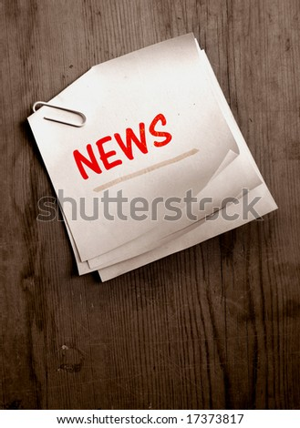Old paper with News word - stock photo