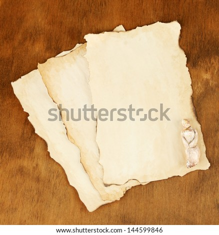 Old papers on wooden background