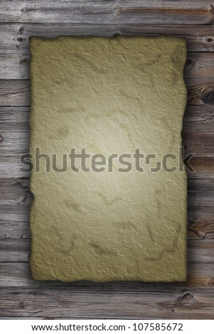 Old papyrus on the wood background - stock photo