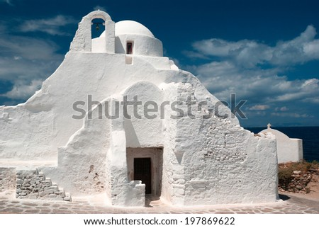 Old Paraportiani 14 century church in the clouds - the most famous and popular place on the island Mikonos in Greece - stock photo