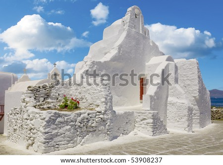 Old Paraportiani 14 century church in the clouds - the most famous and popular place on the island Mikoneos in Greece - stock photo