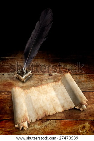 Old Parchment and a Quill in ink well on a table - stock photo