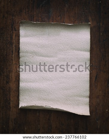 old parchment on wooden background. - stock photo