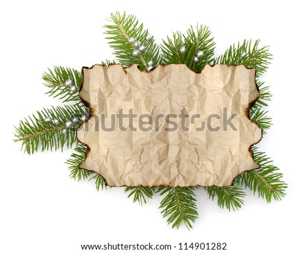 Old parchment paper with copy space on Christmas tree branch background isolated - stock photo