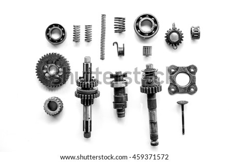 Old parts of motorcycles background with hard light black and white tone. repair and maintenance old parts of engine - stock photo