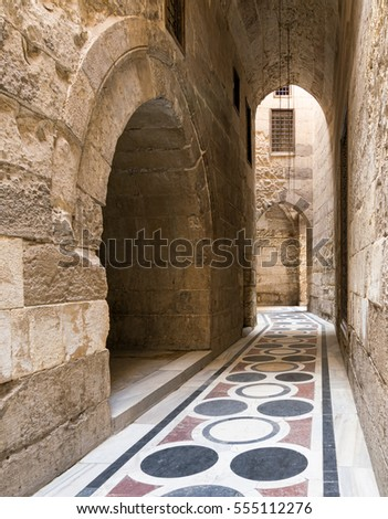 Old passage with stoned vaulted wall leading to an old mosque in Old Cairo, Egypt
