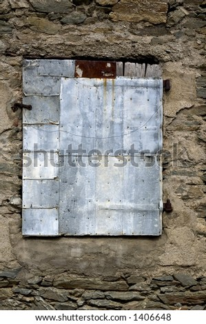 Old patched window - stock photo