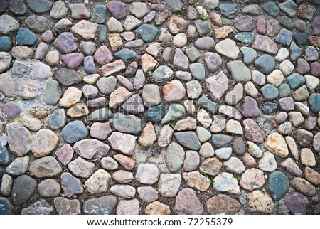 old path paved with cobblestones colorful - stock photo