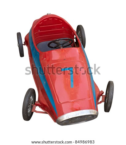 old pedal car for children - red vintage toy car, isolated with clipping path