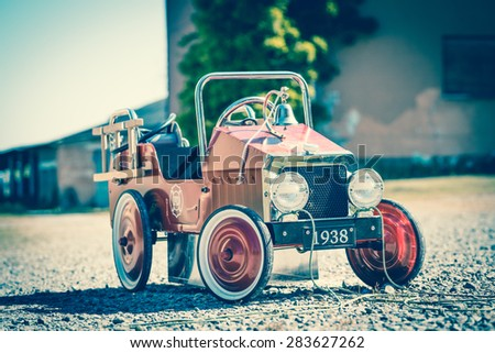 Old pedal firefighter toy car - stock photo