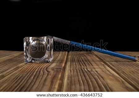 old pen on a black background closeup - stock photo