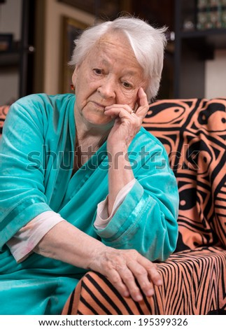Old pensive woman - stock photo