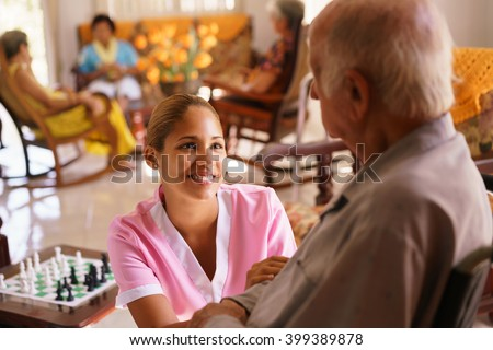 old people geriatric hospice young attractive stock photo 399389878 shutterstock. Black Bedroom Furniture Sets. Home Design Ideas