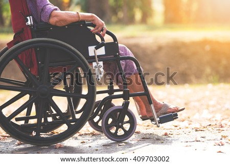 Old people on wheel chair - stock photo