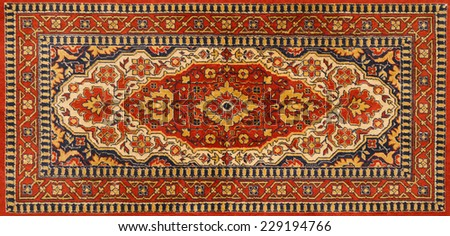 Old Persian red carpet with pattern - stock photo