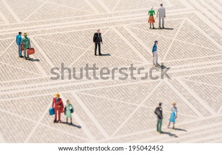Old person miniature - Lonely man standing lost in the middle of a generic square with normal people around - Concept of solitude and elderly - stock photo