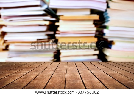 old perspective wooden floor and blur stacking books - stock photo