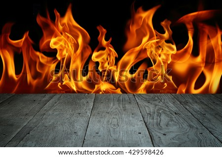 old perspective wooden floor with blaze fire flame - stock photo
