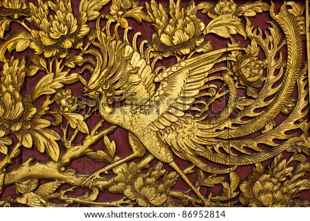 Old phenix golden plate, can be use for background, religion, life, and viltality concepts - stock photo