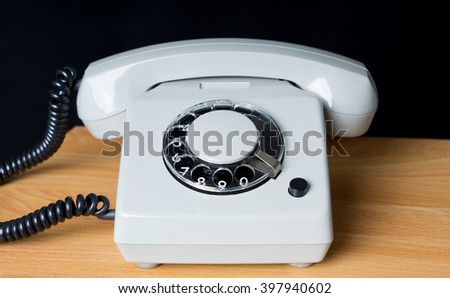 old phone in front of a dark background / Phone - stock photo