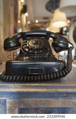 old phone in restaurant interior - stock photo