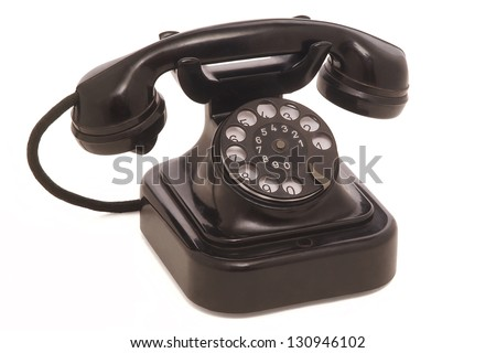 Old phone isolated on white background - stock photo