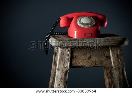 Old phone on a black background - stock photo