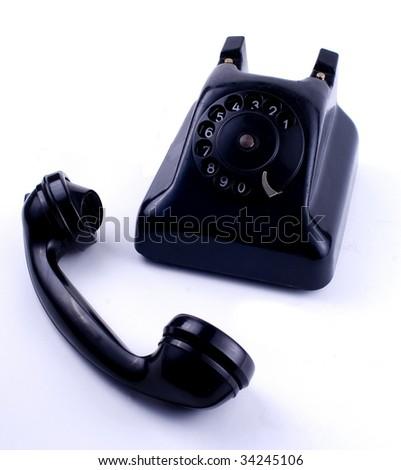 Old phone on white background - stock photo