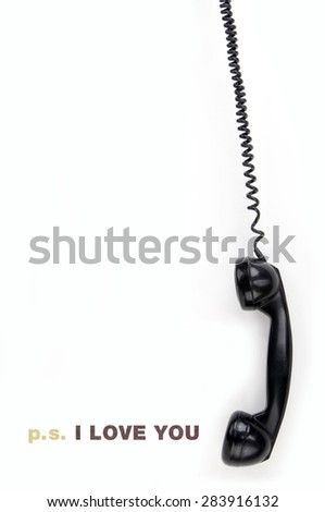 Old phone receiver with inscription love you - stock photo