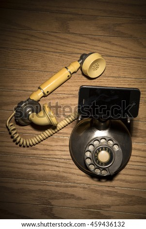 old phone replaced by current technology  - stock photo