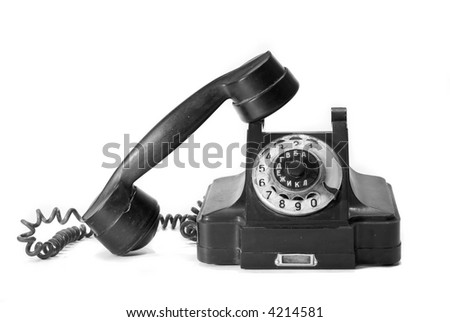 Old phone with Russian letters, and with their half pipe - stock photo