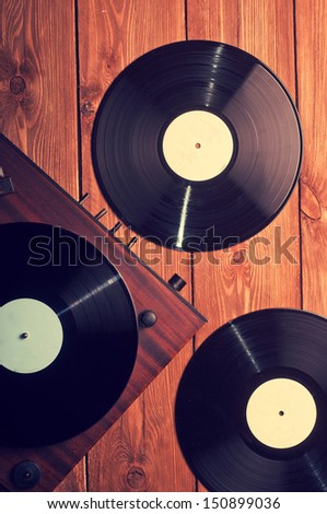 Old phonograph and gramophone records, retouching Vintage - stock photo