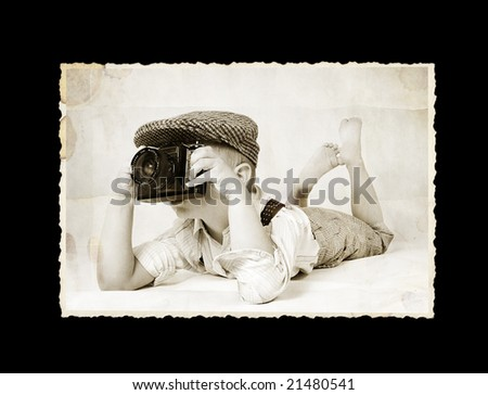 old photo -  boy with vintage camera - stock photo