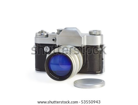 Old photo-camera with lens cap isolated on white